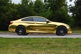 gold chrome bentley bmw m4 wrapped in gold chrome reforma uk