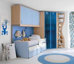 bedroom dark blue glass chest light blue bed flowers curtain