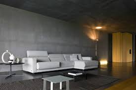 cream sofas on the brown floor of living room concrete paint has