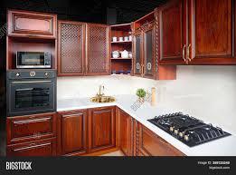 modern kitchen with cherry wood cabinets interior modern image photo free trial bigstock