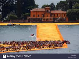 Floating Piers by People Walk On The Installation U0027the Floating Piers U0027 On Lake Iseo