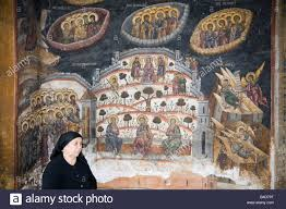 religious mural on church stock photos religious mural on church cozia transylvania romania europe old woman by religious painting on wall outside church in 14th century