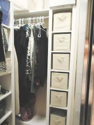 l shaped white stained wooden walk in closet for cloths and shoes