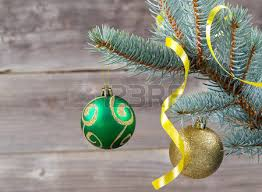 vertical image of ornaments and green hanging