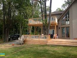 2 level cedar deck at a cottage m e contracting toronto