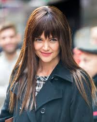 katie holmes debuts new fringed hairstyle