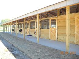 shedrow barn door grates are economical to build horses