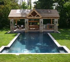 outdoor stylish backyard with pool extra space outdoor kitchen
