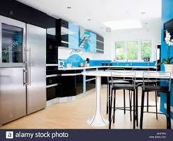 White Blue Kitchen Black Stools At Fitted White Table In Blue And Black Modern