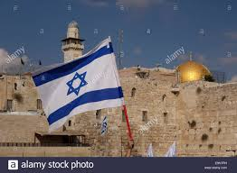 israeli flag with view of dome of the rock mosque also called haram