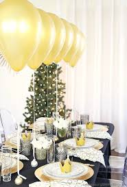party table table setting with balloons centerpiece dinner party