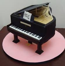 piano cake topper baby grand piano cake cake is supported on pillars i covered in