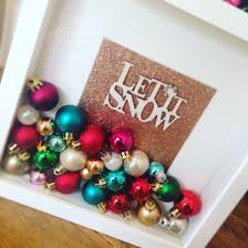 white shadow box frame with bronze glitter backing multi coloured