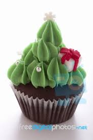 christmas tree cupcake on white background stock photo royalty