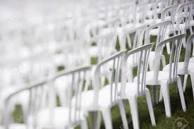 white plastic chairs set for an outdoor event stock photo picture
