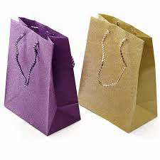 purple gift bags purple and gold glitter gift bags
