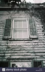 Houses In New Jersey Creepy Window With Wooden Shutters In An Abandoned Colonial Style
