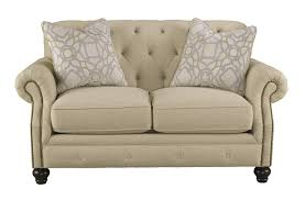 Traditional Tufted Sofa by Ashley 4400035 Kieran Natural Tone Fabric Traditional Tufted Loveseat