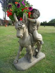 Rocking Bird Garden Ornament donkey with cart garden statues hidden amongst the flowers a