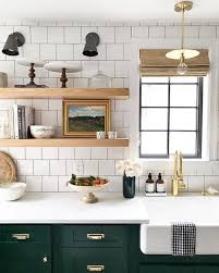 green lower white kitchen cabinets white tile open shelving farmhouse sink and green