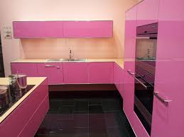 delightful kitchen set with black ceramic flooring idea and pink
