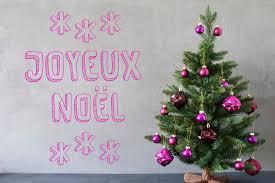 tree cement wall text joyeux noel means merry stock