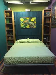 Hide A Beds Ikea by Murphy Bed Hidden Behind Bookshelves On Wheels To Turn Around For