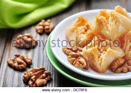traditional turkish arabic dessert baklava with honey and nuts