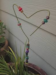 metal clothing hanger garden ornaments i used a metal hanger a metal hanger beads and colored wire to make it easy and cute