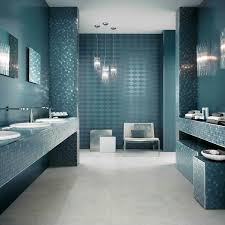 bathroom modern white toilet on dark brown bathroom floor tile luxury sparkling triple pendant lamps in grey blue bathroom interioe design combined with a white