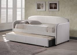 contemporary white upholstered daybed with trundle and gray linen