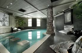 decorating spectacular indoor swimming pool design idea with clear