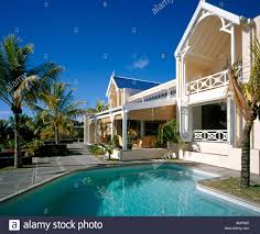 la maison tropical house with verandahs and swimming pool