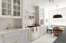 interiors light gray kitchen cabinet with white marble countertop