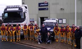 land rover rnli haulage company drives to the aid of angle rnli rnli