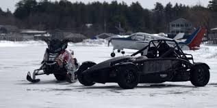 polaris snowmobile ariel atom meets polaris snowmobile in drag race on ice strip