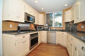 blue pearl granite with white cabinets blue pearl granite countertops pictures cost pros and cons