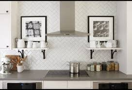breathtaking light gray kitchen backsplash using herringbone tile