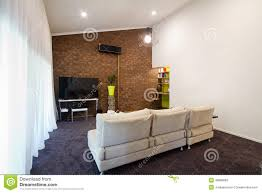 renovated 70s exposed brick wall apartment living room stock photo