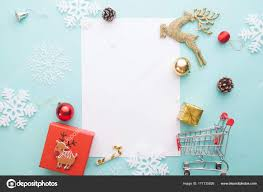 creative flat lay of gift box and ornaments with blank paper for