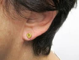 earrings on ear certified fancy yellow emerald cut diamond