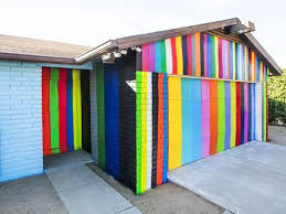 paints for home art or an eyesore peoria man paints home with rainbow stripes