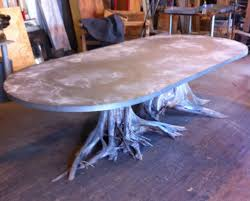 one of a kind large double tree root dining table with zinc oval