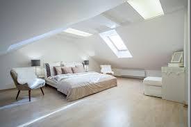 bedroom grey orange bedroom bench white bedcover wall lamps