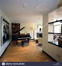 piano in living room grand piano in living room in modern city apartment with parquet