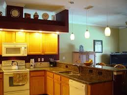 under cabinet light fixtures fluorescent kitchen light fixtures cream wooden floor blue neon