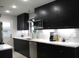 white kitchen cabinets and black quartz countertops white quartz countertops with black cabinets stoneadd photo