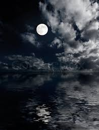moon and clouds above sea at photo stock photo colourbox