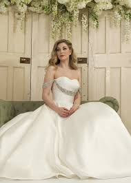 plain and simple ballgown wedding dress with off shoulder detail