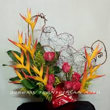 parrot haliconia anthurium roses and decorative wire heart